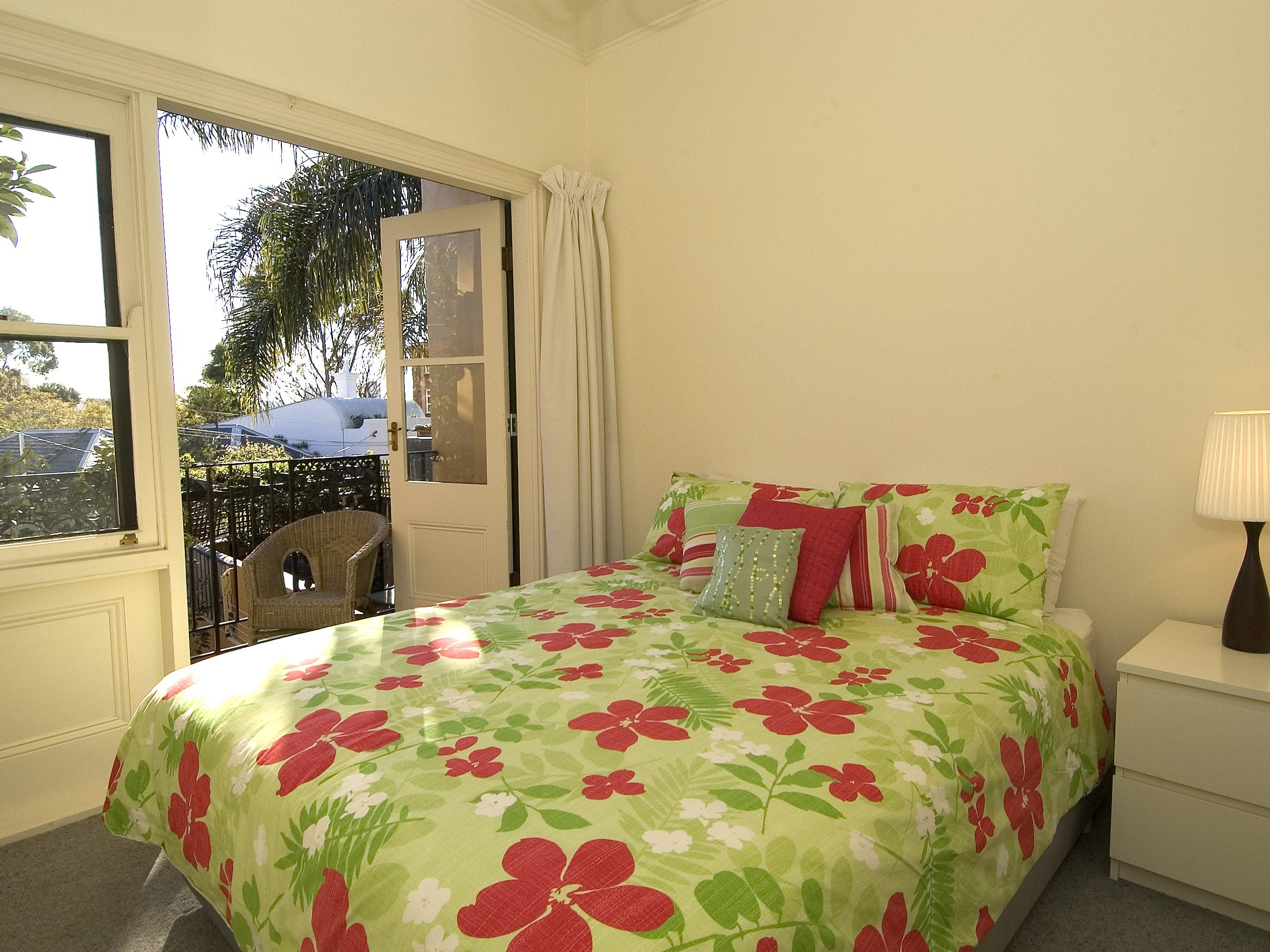 Queen bedroom with air conditioning, heating and balcony with views
