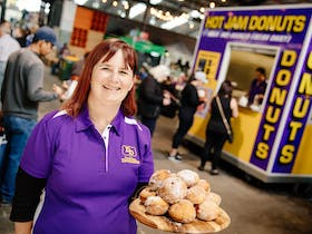 Woman holding Dandee Donuts