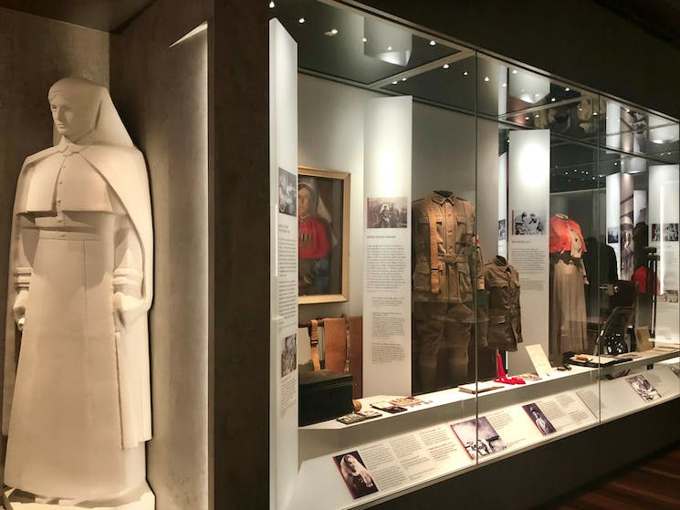 A Centenary Exhibition showcase featuring a reproduction of Rayner Hoff's Matron
