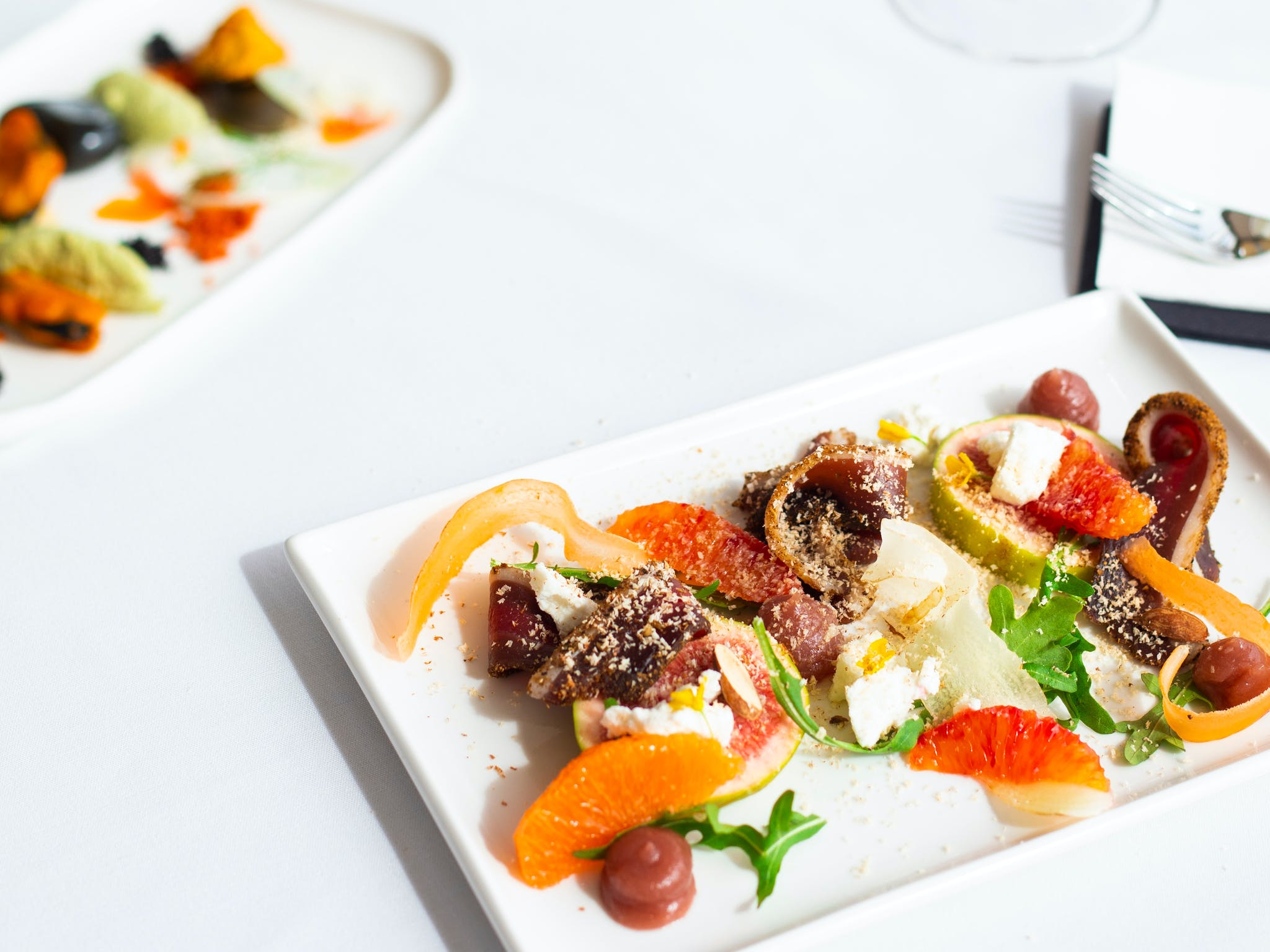 Delicious, vibrantly coloured duck and seafood entree dishes presented to diners, Atrium Wangaratta