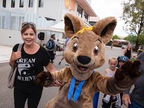 woman with a kangaroo mascot