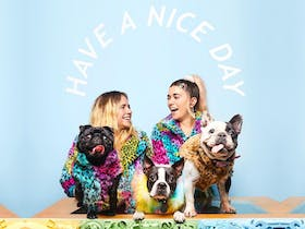 Alicia and Jade at the counter with their three dogs