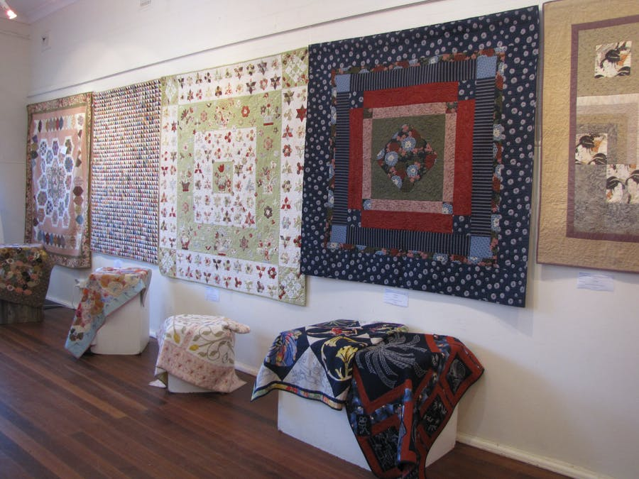 Quilts displayed on the wall