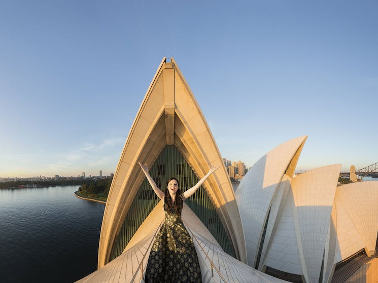 An opera singer sings on top of the sails of the Sydney Opera House