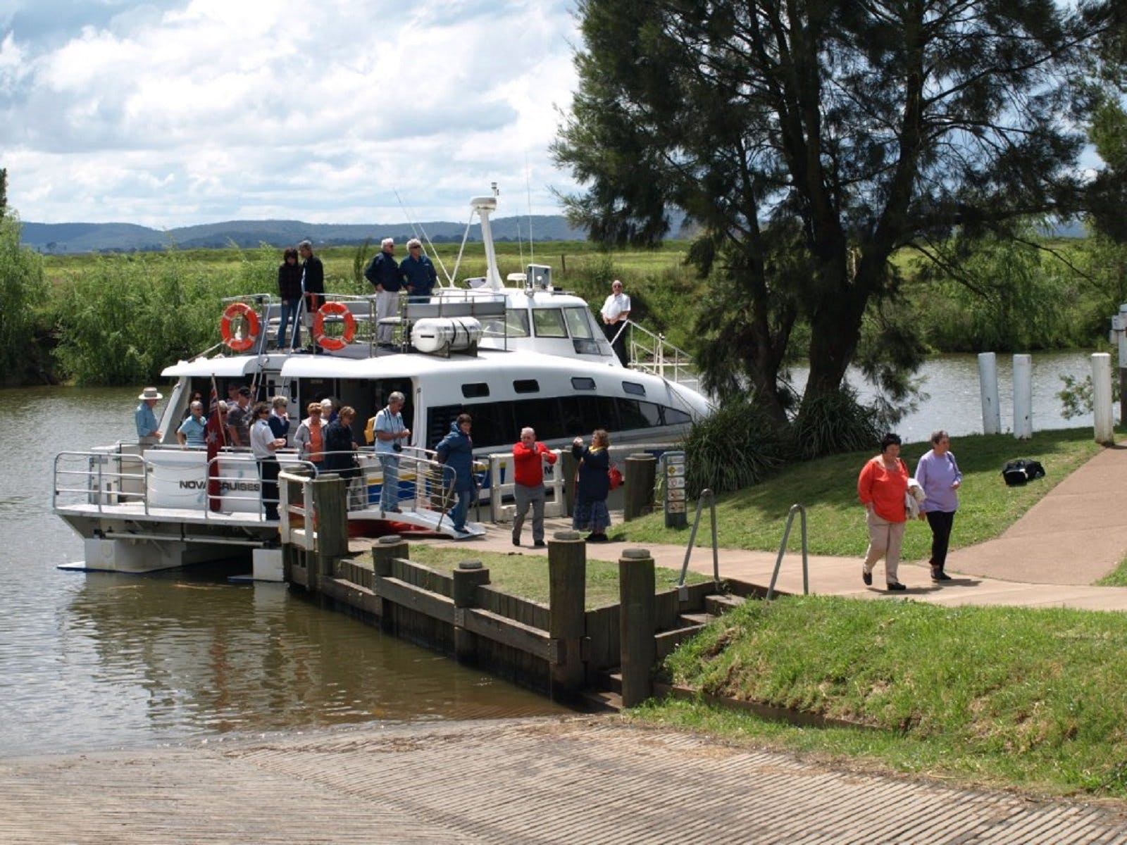 Guests getting off the vessel 'Bay Connections' heading towards Morpeth