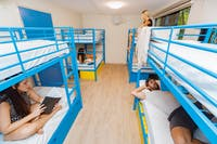 Four bunk beds and four friends