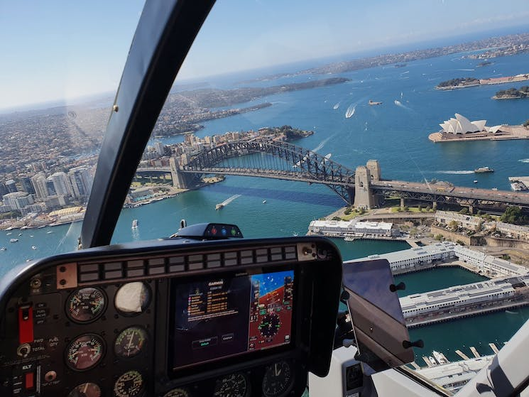 Helicopter cockpit photo about to fly over the Sydney Harbour Bridge