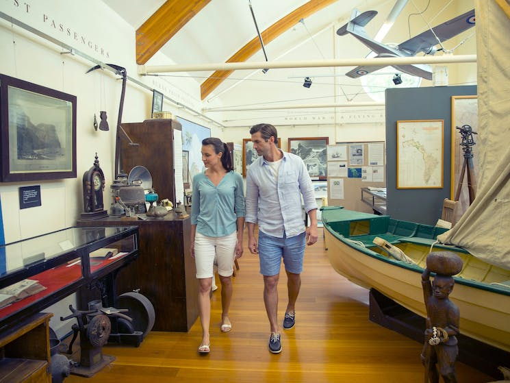 Couple viewing the historic artifacts major collection on a visit to the Lord Howe Island Museum
