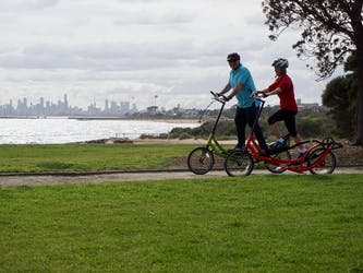ElliptiGO riding in Brighton with view of Melbourne City