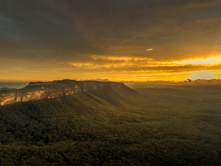 Rich yellow glow of the setting sun across the Megalong Valley