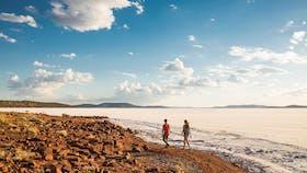 Couple walking along the shore of Lake Gairdner, Eyre Peninsula