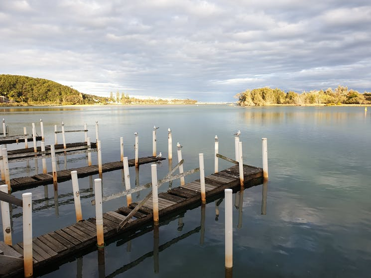 A view of the Nambucca River and the jetties at the rear of Wharf Street Cafe.