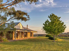 Exterior of Simon Tolley Lodge in the Adelaide Hills, overlooking the vines