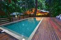Rainforest surrounded saltwater pool and deck at Cape Trib Beach House
