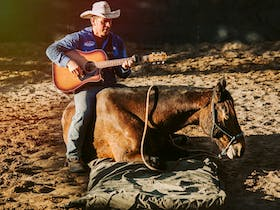 Tom Curtain singing with Legend the Horse at the Katherine Outback Experience