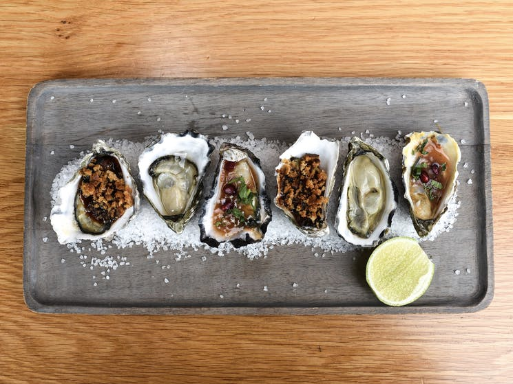 Oysters: natural, watermelon & pomegranate rojo, pancetta crumble
