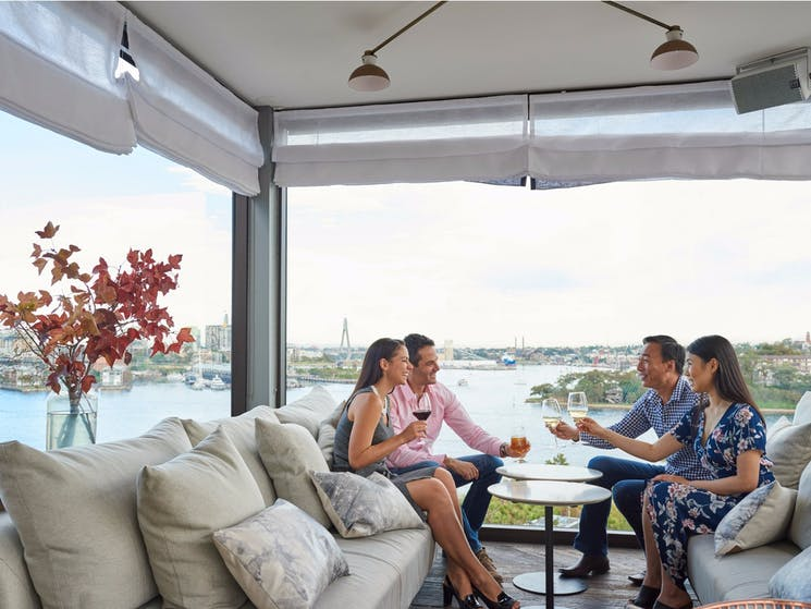 Couples enjoying drinks with Harbour views at Henry Deane