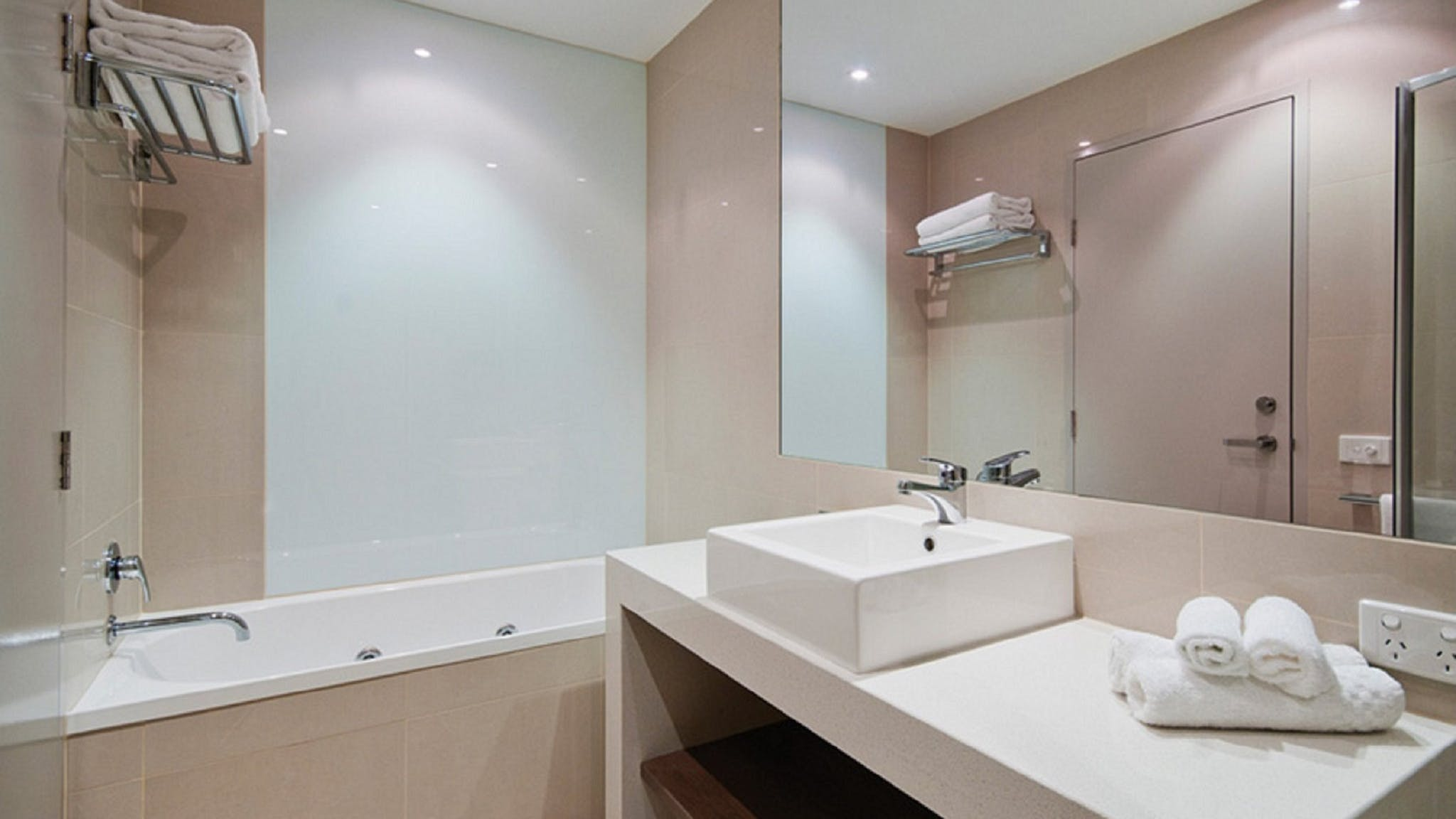 The Gateway's Apartments include bathroom with spa bath and separate toilet