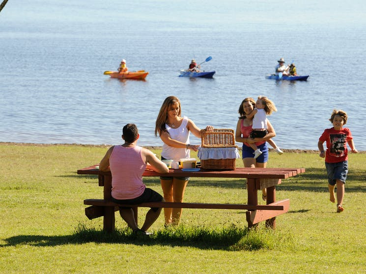 A family enjoying a picnic at Reflections Holiday Parks Copeton Waters