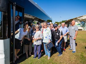 Happy customers on bus tour