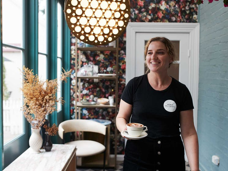 Waitress holding a coffee