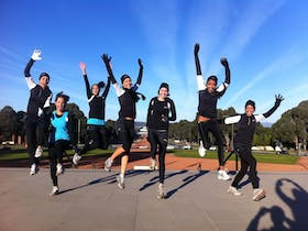 Participants from the Australian Running Festival jumping for joy