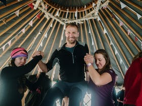 Acro Yoga in the Forest Yurts at Cradle Mountain Film Festival
