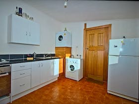 Kitchen with 8 function oven, gas hob, washing machine, dryer not available