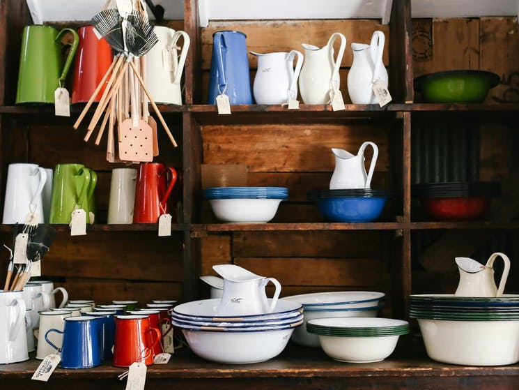 Falcon and Romanian enamelware on the original packing case shelves.