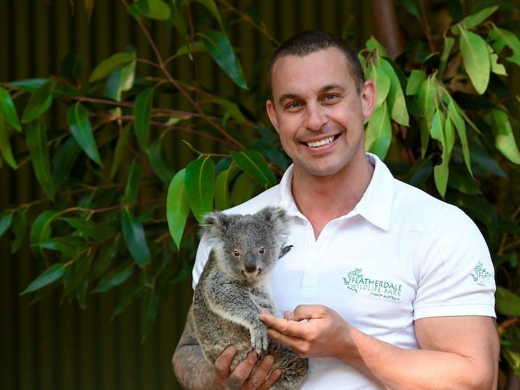 "Zookeeper Chad Staples with Bungarribee  ""Gabbie"" the koala joey"