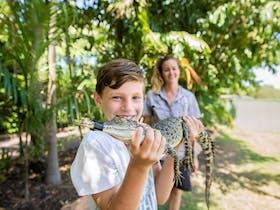 Child Holding Croc