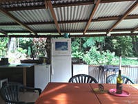 Inside The Shed showing BBQ and table