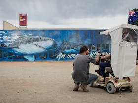 Andrew Bourke chatting to Tumby local Tom in front of his finishe Great White Mural