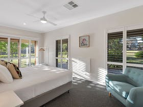 A guest bedroom at Simon Tolley Lodge, Adelaide Hills Vineyard Accommodation