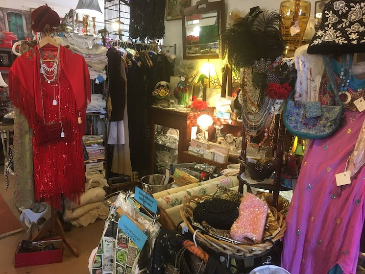 A variety of beaded dresses, headwear, evening bags and jewellery